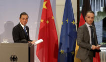 German Foreign Minister Heiko Maas, right, and China's Foreign Minister Wang Yi, left, leave after a joint press conference as part of a meeting in Berlin, Germany, Tuesday, Sept. 1, 2020. (AP Photo/Michael Sohn, pool)