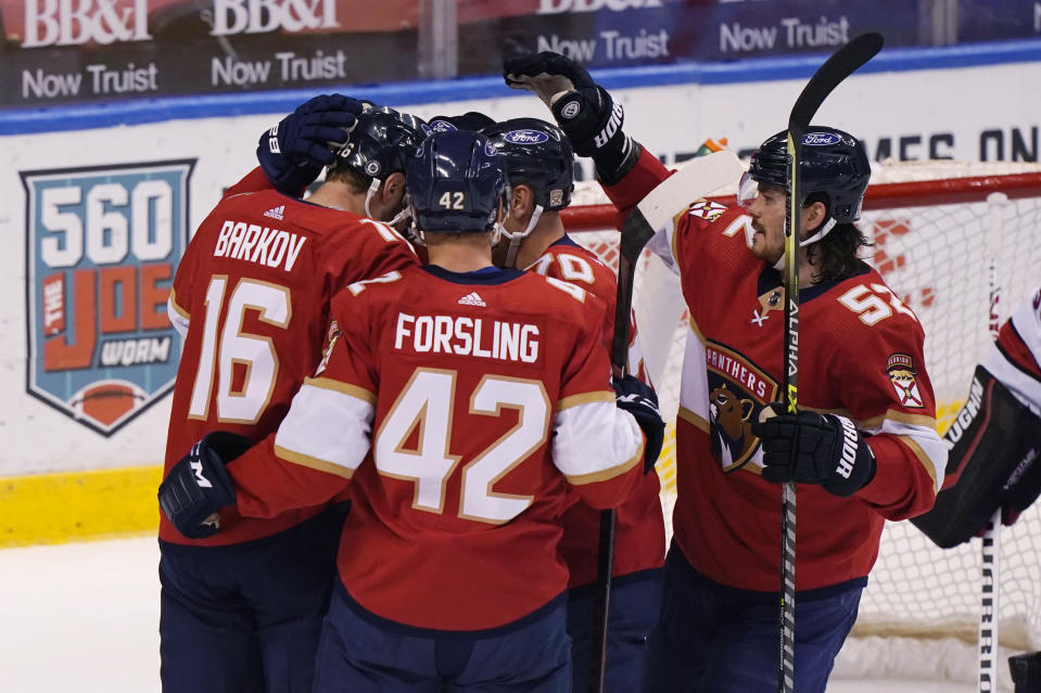 Florida Panthers celebrate a goal by center Aleksander Barkov (16) during the first period of an NHL hockey game against the Carolina Hurricanes, Thursday, April 22, 2021, in Sunrise, Fla. (AP Photo/Marta Lavandier)