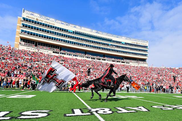 The Texas Tech Red Raiders mascot 'Masked Rider' runs down the field before a game against West Virginia. (AP)