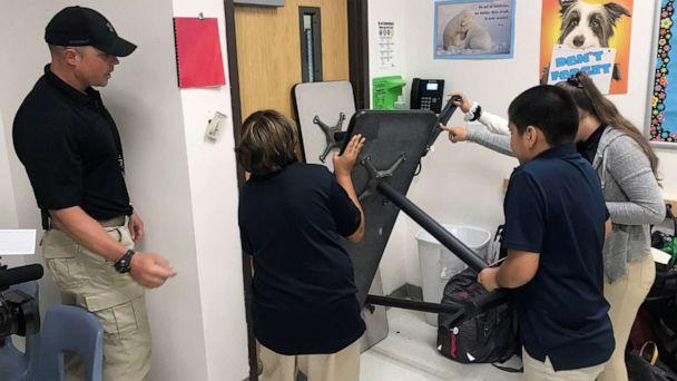 PHOTO: Joe Deedon, owner of Tac One Consulting, instructs sixth graders at Pinnacle Middle School in Denver how to barricade a classroom to stop an active shooter. (ABC News)