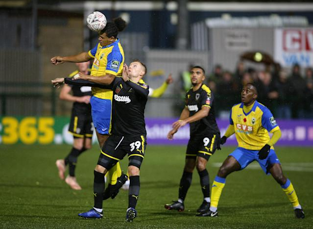 Haringey Borough's Coby Rowe (left, pictured in a match against AFC Wimbledon) was subjected to alleged racist abuse against Yeovil. (Photo by Nigel French/PA Images via Getty Images)