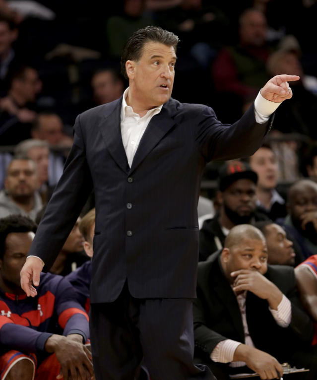 St. John's head coach Steve Lavin points during the first half of an NCAA college basketball game against Providence in the second round of the Big East Conference tournament at Madison Square Garden, Thursday, March 13, 2014, in New York. (AP Photo/Seth Wenig)
