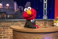 """This image released by Sesame Workshop shows muppet character Elmo, host of the family friendly show called """"The Not Too Late Show with Elmo"""" on HBO Max. The series took home the GLAAD award for Outstanding Children's Programming. (Richard Termine/Sesame Workshop via AP)"""