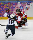 Meghan Duggan of the United States (10) collides with Tara Watchorn of Canada (27) during the first period of the women's gold medal ice hockey game at the 2014 Winter Olympics, Thursday, Feb. 20, 2014, in Sochi, Russia. (AP Photo/Julio Cortez)