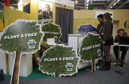Plant for the Planet Foundation members speak together during the World Climate Change Conference 2015 (COP21) in Le Bourget, near Paris, France, December 3, 2015. REUTERS/Jacky Naegelen