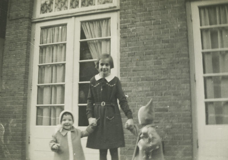 In this 1940 photo provided by the Anne Frank House Amsterdam on Tuesday, Feb. 4, 2014, Toosje Kupers, centre, poses with two girls in Amsterdam. Shortly before Anne Frank and her family went into hiding from the Nazis, she gave away some of her toys to non-Jewish neighborhood girlfriend Toosje Kupers for safekeeping. The toys have now been recovered and Anne's tin of marbles will go on display for the first time this week at an art gallery in Rotterdam, the Anne Frank House Museum says. (AP Photo/Anne Frank House Amsterdam/Toosje Kupers photo collection)