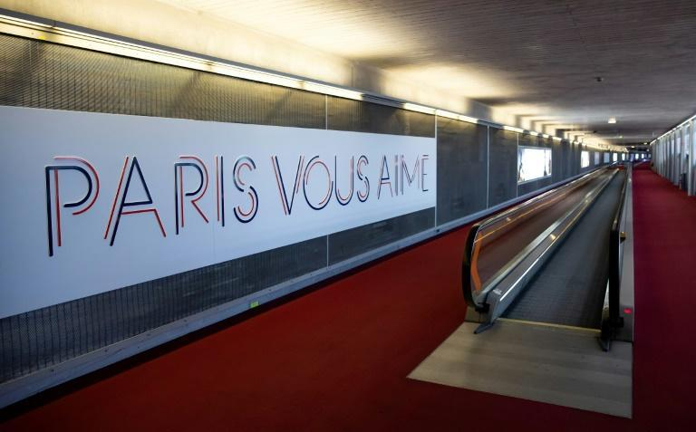 """A sign reading """"Paris loves you"""" adorns one arrivals hall in the French capital's Charles de Gaulle airport"""