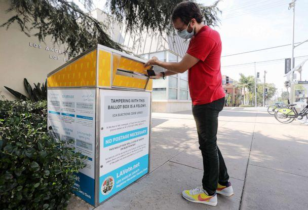 PHOTO: Voter Cody Crump places his ballot in a mail-in ballot drop box outside of a library ahead of Election Day, Oct. 5, 2020, in Los Angeles. (Mario Tama/Getty Images)