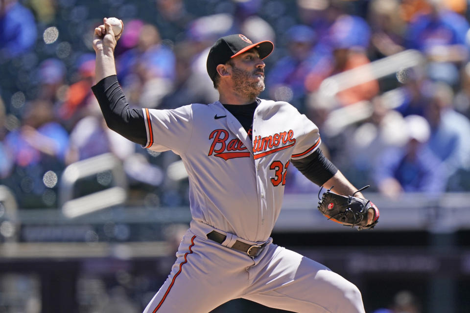 Baltimore Orioles starting pitcher Matt Harvey (32) winds up during the first inning of a baseball game against the New York Mets, Wednesday, May 12, 2021, in New York. (AP Photo/Kathy Willens)