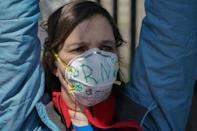 Members of the medical staff listen as Montefiore Medical Center nurses call for N95 masks and other 'critical' PPE to handle the coronavirus (COVID-19) pandemic on April 1, 2020 in New York (AFP Photo/Bryan R. Smith)