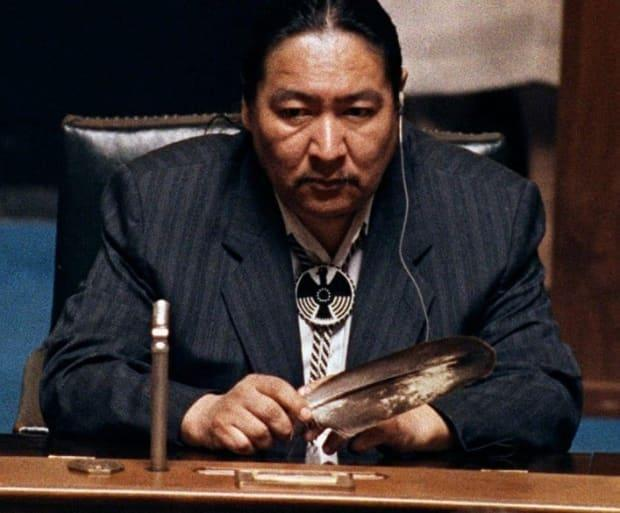 Elijah Harper, a Manitoba MLA and MP played a key role in defeating the Meech Lake accord. Harper holds an eagle feather for spiritual strength as he refused to support the Meech Lake accord in Winnipeg in 1990.