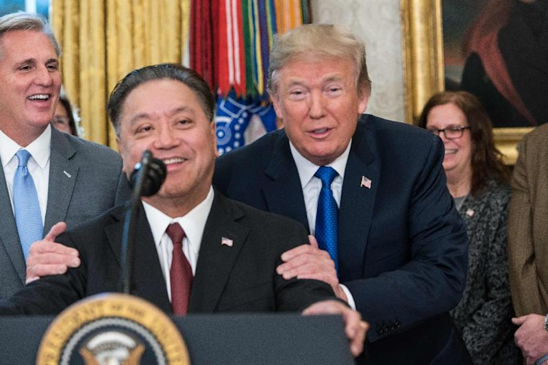 Broadcom CEO Hock Tan visited the White House last November where he told President Donald Trump the chipmaker would be moving back to the US (AFP Photo/NICHOLAS KAMM)