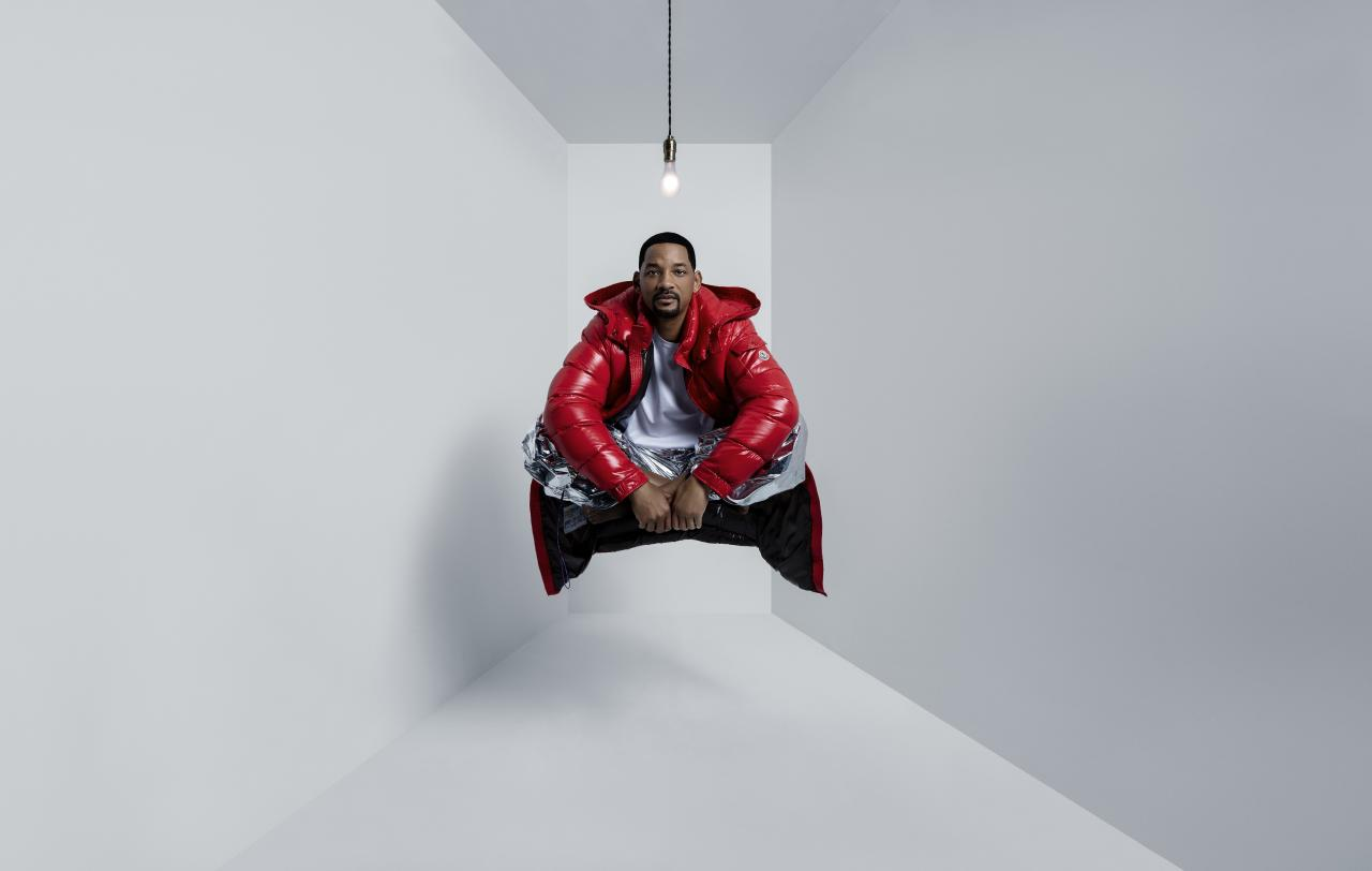 """In his long and storied career in Hollywood it's hard to believe Will Smith hasn't starred in dozens of fashion campaign in his nearly three-decades in front of the camera. But at 50 years old, he finally nabbed his first fashion gig by teaming up with Moncler for the brand's newest campaign: """"Genius Is Born Crazy.""""  And he's a natural fit to help elevate the brand's imaginative innovation. """"Will Smith serves as a natural face for the Moncler campaign. As an actor, producer and musician, two-time Academy Award nominee and Grammy winner, Will brings an outsized imagination and dedication to creativity,"""" the press release states."""