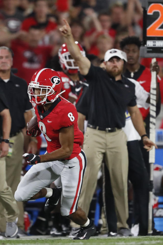 Georgia wide receiver Dominick Blaylock (8) runs up the sidelines against Notre Dame during the first half of an NCAA college football game, Saturday, Sept. 21, 2019, in Athens, Ga. (AP Photo/John Bazemore)