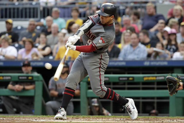 Arizona Diamondbacks' Jon Jay drives in two runs with a double off Pittsburgh Pirates starting pitcher Chad Kuhl during the second inning of a baseball game in Pittsburgh, Thursday, June 21, 2018. (AP Photo/Gene J. Puskar)