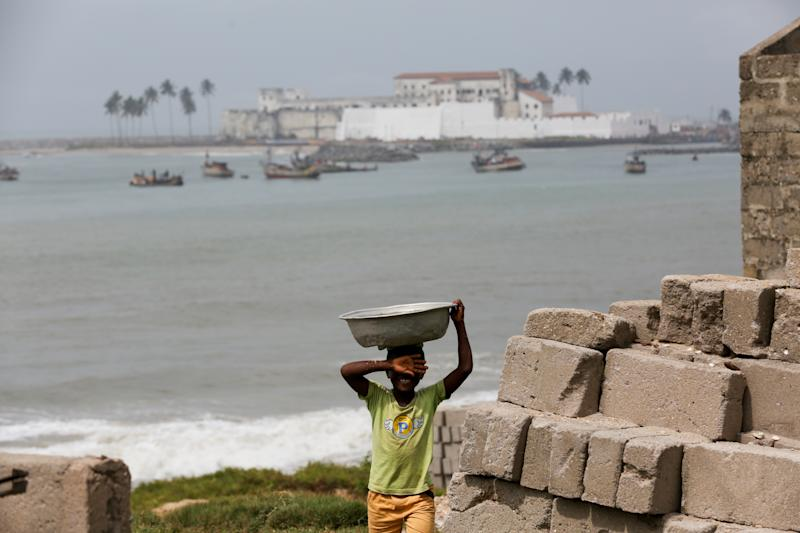 A boy, with Elmina Castle in the background in Elmina, Ghana. (Photo: Siphiwe Sibeko/Reuters)