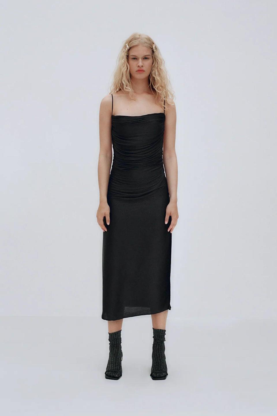 <p>Bring the sexy in this <span>Draped Midi Dress</span> ($50) for a night out, or pair it with sneakers and a light jacket for an easygoing daytime look.</p>