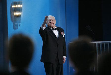 Actor Mickey Rooney waves to the audience as he presents the award for Outstanding Female Actor in a TV Movie or Miniseries at the 14th annual Screen Actors Guild Awards in Los Angeles in this January 27, 2008 file photo. REUTERS/Mario Anzuoni/Files