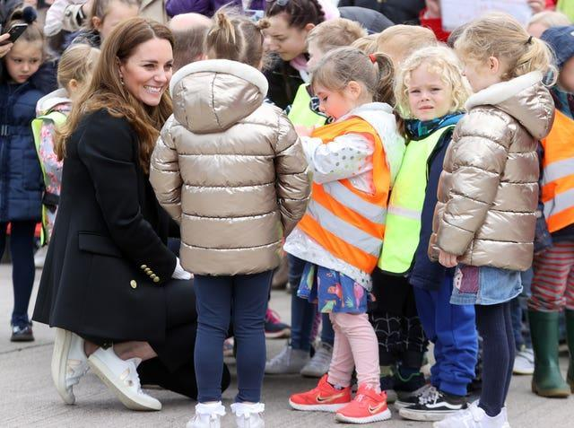 Kate speaks with young children during a meeting (Chris Jackson/PA)