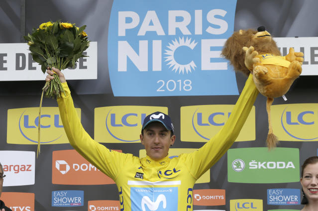 Winner of the Paris-Nice cycling race, Marc Soler of Spain, celebrates on the podium in Nice, southeastern France, Sunday, March 11, 2018. (AP Photo/Claude Paris)
