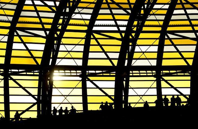 GDANSK, POLAND - JUNE 10: Football fans are silhouetted against the stadium wall during the UEFA EURO 2012 group C match between Spain and Italy at The Municipal Stadium on June 10, 2012 in Gdansk, Poland. (Photo by Shaun Botterill/Getty Images)