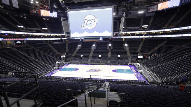 An empty Vivint Smart Home Arena is seen as the building was being evacuated because of a suspicious package following the Utah Jazz's NBA basketball game against the Golden State Warriors on Friday, Nov. 22, 2019, in Salt Lake City. Most fans had already left the building when players, coaches and reporters were instructed to leave the arena following Utah's 113-109 victory over the Warriors. (AP Photo/Rick Bowmer)