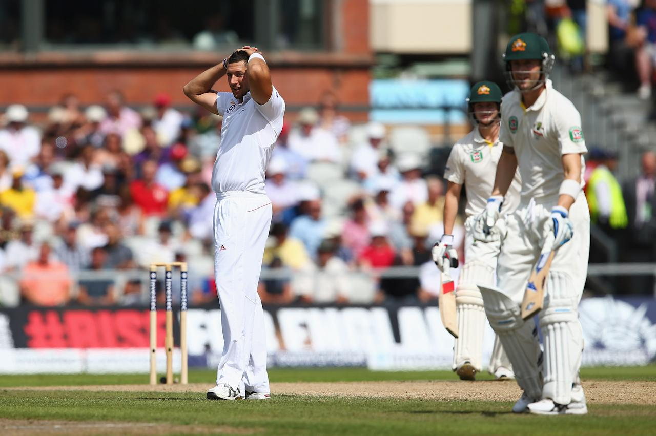 MANCHESTER, ENGLAND - AUGUST 02:  Tim Bresnan of England holds his head as Steve Smith and Michael Clarke (R) of Australia look on during day two of the 3rd Investec Ashes Test match between England and Australia at Emirates Old Trafford Cricket Ground on August 2, 2013 in Manchester, England.  (Photo by Michael Steele/Getty Images)