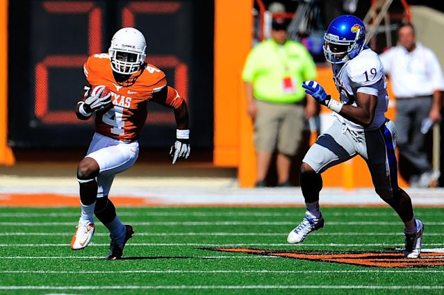 AUSTIN, TX - NOVEMBER 02: Justin McKay #19 of the Kansas Jayhawks pursues Daje Johnson #4 of the Texas Longhorns during a game at Darrell K Royal-Texas Memorial Stadium on November 2, 2013 in Austin, Texas. Texas won the game 35-13. (Photo by Stacy Revere/Getty Images)