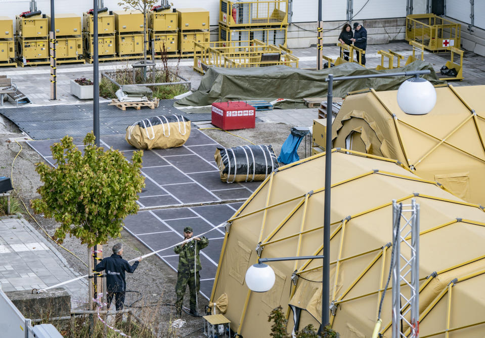 Military and personnel from the National Swedish Board of Health and Welfare dismantle a field hospital in Helsingborg, Sweden, Wednesday Sept. 9, 2020. Sweden's relatively low-key approach to coronavirus lockdowns captured the world's attention when the pandemic first hit Europe. But it also had a per capita death rate much higher than other Nordic countries. Now, as infection numbers surge in much of Europe, Sweden has some of the lowest numbers of new cases and there are only 14 people being treated for the virus in intensive care in the country of 10 million. (AP Photo/TT News Agency/Johan Nilsson)