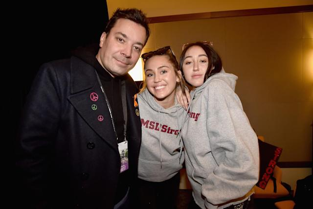 <p>Jimmy Fallon, Miley Cyrus, and Noah Cyrus at the Washington, D.C. March for Our Lives event, where Miley performed. (Photo: Getty Images) </p>
