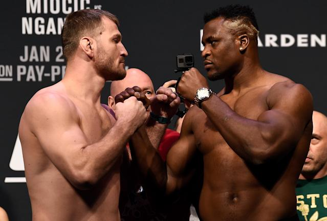 Stipe Miocic and Francis Ngannou of Cameroon face off at the UFC 220 weigh-in at TD Garden. (Getty Images)