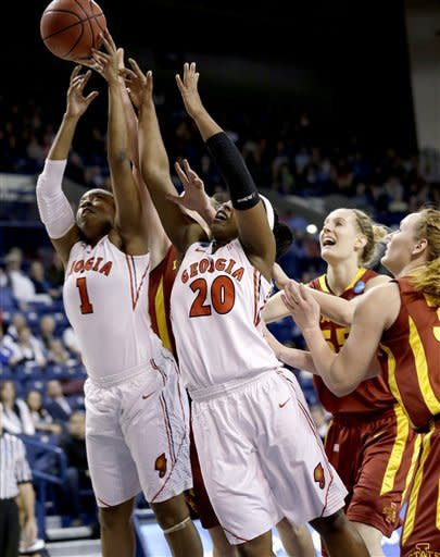 Georgia's Khaalidah Miller (1) and Shacobia Barbee (20) reach for a rebound in front of Iowa State players in the first half of a second-round game in the women's NCAA college basketball tournament in Spokane, Wash., Monday, March 25, 2013. (AP Photo/Elaine Thompson)