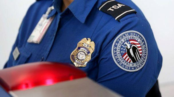 PHOTO: Transportation Security Administration (TSA) agents work at a check-point inside LaGuardia airport in New York, Jan. 27, 2014. (John Moore/Getty Images, FILE)