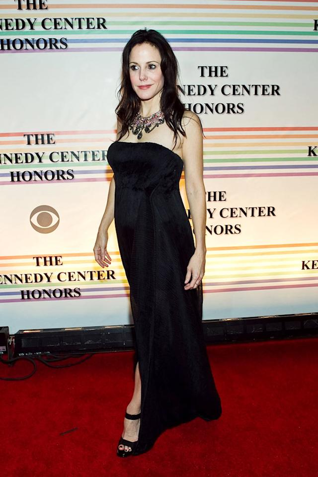 """""""Weeds"""" star Mary-Louise Parker was glamorous in a long black gown and statement necklace. Paul Morigi/<a href=""""http://www.wireimage.com"""" target=""""new"""">WireImage.com</a> - December 5, 2010"""
