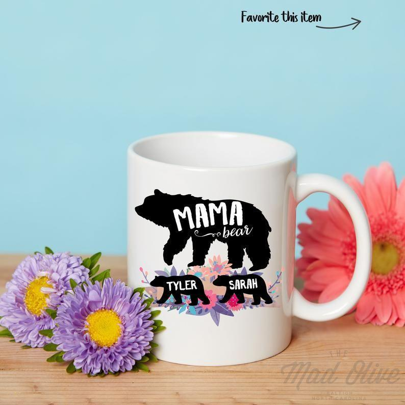 """<p><strong>MadOliveShop</strong></p><p>etsy.com</p><p><strong>$14.80</strong></p><p><a href=""""https://go.redirectingat.com?id=74968X1596630&url=https%3A%2F%2Fwww.etsy.com%2Flisting%2F480456667%2Fmama-bear-mug-baby-shower-mug-gift-for&sref=https%3A%2F%2Fwww.womansday.com%2Flife%2Fg971%2Fgifts-under-20-dollars%2F"""" rel=""""nofollow noopener"""" target=""""_blank"""" data-ylk=""""slk:SHOP NOW"""" class=""""link rapid-noclick-resp"""">SHOP NOW</a></p><p>Mama Bear will love sipping her morning coffee out of this personalized mug, which can feature up to four cubs and is available in a rainbow of colors. </p>"""