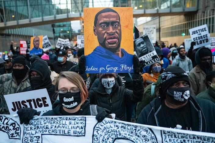 Protesters march around downtown Minneapolis near the courthouse calling for justice for George Floyd after closing arguments in the Chauvin trial has ended on Monday, April 19, 2021 in Minneapolis, MN. (Jason Armond/Los Angeles Times via Getty Images)