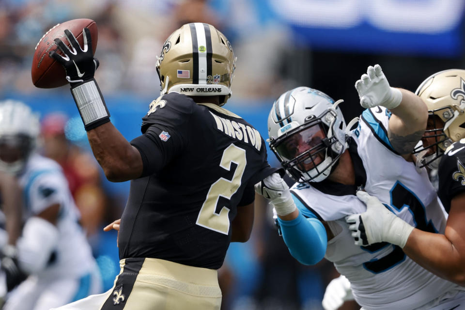 New Orleans Saints quarterback Jameis Winston passes under pressure from Carolina Panthers defensive end Morgan Fox during the first half of an NFL football game Sunday, Sept. 19, 2021, in Charlotte, N.C. (AP Photo/Nell Redmond)