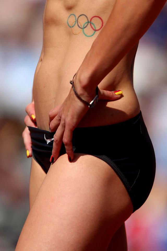 LONDON, ENGLAND - AUGUST 09: A detailed view of the Olympic Rings tattoo on the abdomen of Ariane Friedrich of Germany during the Women's High Jump qualification on Day 13 of the London 2012 Olympic Games at Olympic Stadium on August 9, 2012 in London, England. (Photo by Alexander Hassenstein/Getty Images)