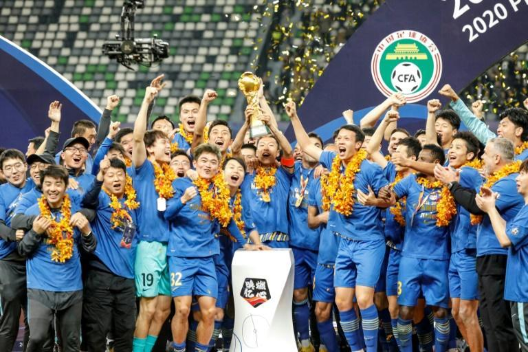 Jiangsu Suning celebrate beating Guangzhou Evergrande to win the Chinese Super League last month, but both clubs may have to change their names for next season