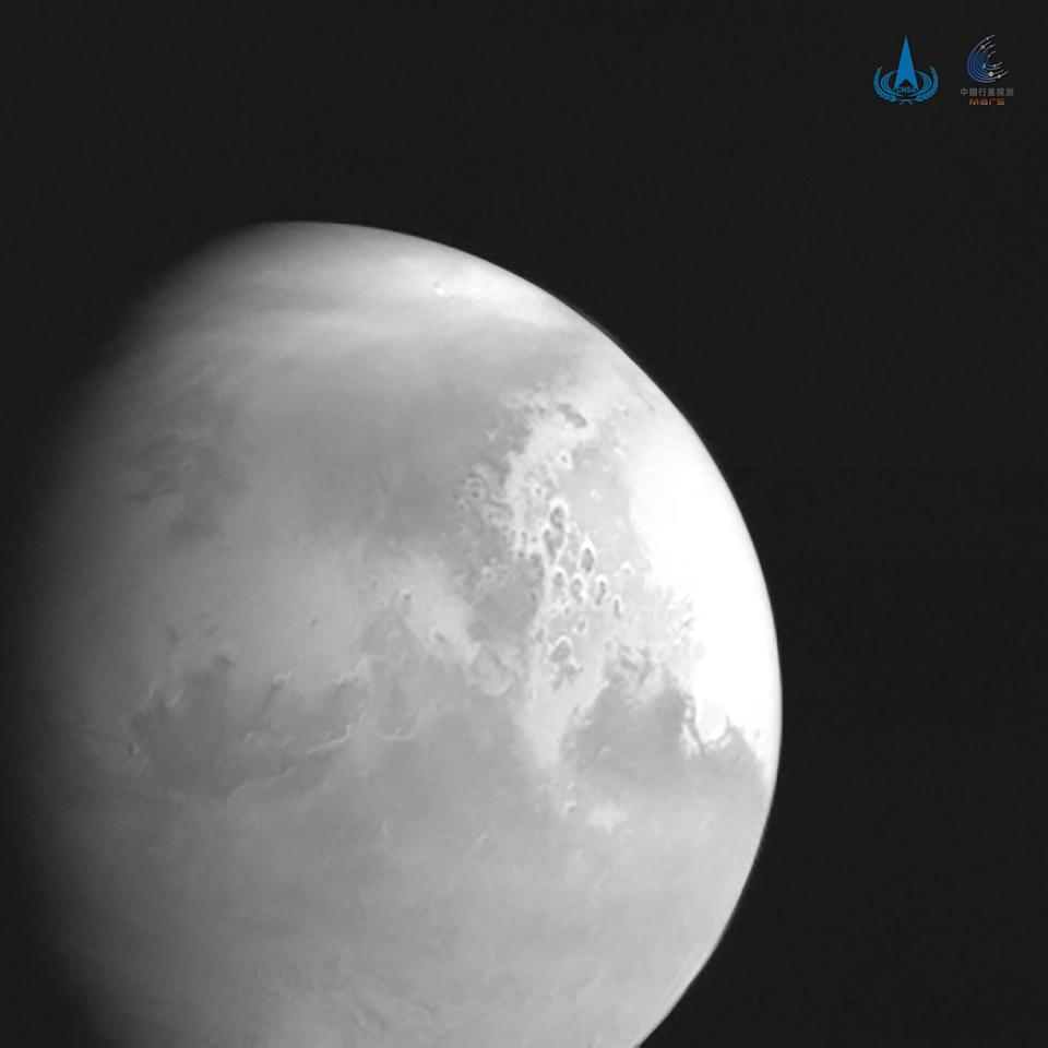 BEIJING, Feb. 5, 2021 -- Photo released by the China National Space Administration CNSA shows the first image of Mars captured by Mars probe Tianwen-1 from a distance of 2.2 million km. China's Mars probe Tianwen-1 conducted its fourth orbital correction Friday night, according to the CNSA.    The probe carried out the orbital correction at 8 p.m. Beijing time, aiming to ensure that the probe achieves a sound planned rendezvous with Mars.    The CNSA also said the probe had captured the first image of Mars from a distance of 2.2 million km.    The probe has traveled about 197 days in orbit, flying about 465 million km. It is currently 184 million km from Earth and 1.1 million km from Mars. All probe systems are in good working condition, the CNSA said. (Photo by Xinhua via Getty) (Xinhua/Xinhua via Getty Images)