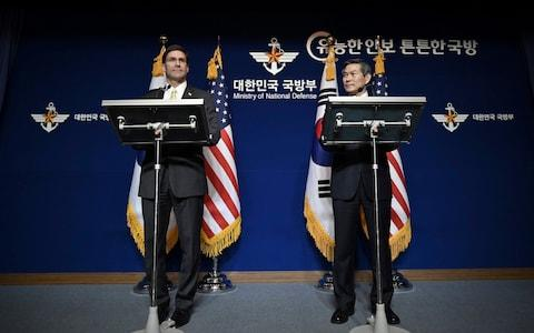 US Defense Secretary Mark Esper, left, and South Korean Defense Minister Jeong Kyeong-doo, hold a joint press conference - Credit: Jung Yeon-je/Pool Photo via AP