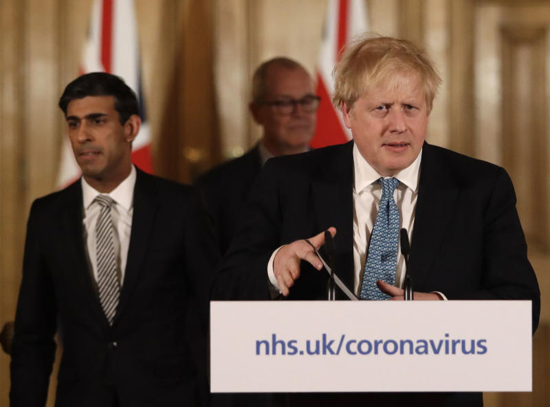 Britain's Chancellor Rishi Sunak, British Prime Minister Boris Johnson and Chief scientific officer Patrick Vallance arrive for a press briefing about the ongoing situation with the COVID-19 coronavirus outbreak, inside 10 Downing Street in London, Tuesday, March 17, 2020. For most people, the new coronavirus causes only mild or moderate symptoms, such as fever and cough. For some, especially older adults and people with existing health problems, it can cause more severe illness, including pneumonia. (AP Photo/Matt Dunham, Pool)