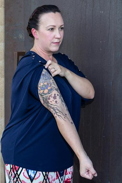 MJ Hegar of Texas, an Air National Guard veteran and 2018 Democratic candidate for the House of Representatives, shows the tattoos that she says helped her reclaim parts of her body that were scarred when her rescue helicopter was shot down in Afghanistan