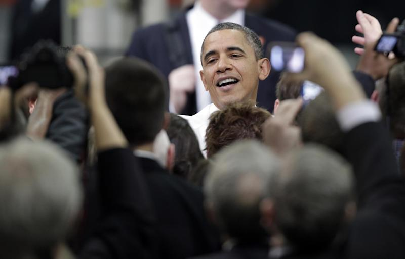 President Barack Obama greets workers and guests after speaking at the Linamar Corporation plant in Arden, N.C., Wednesday, Feb. 13, 2013, as he travels after delivering his State of the Union address Tuesday. (AP Photo/Chuck Burton)