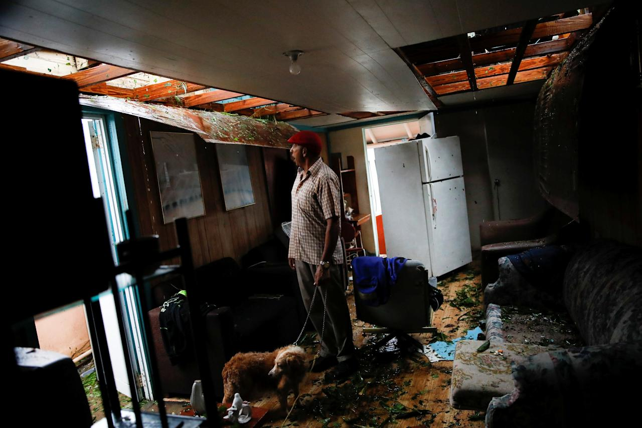 <p>Agapito Lopez looks at the damage in his house after the area was hit by Hurricane Maria in Guayama, Puerto Rico, Sept. 20, 2017. (Photo: Carlos Garcia Rawlins/Reuters) </p>