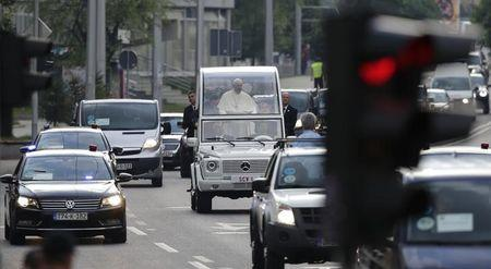 Pope Francis stands in his Papamobile during a visit to Sarajevo
