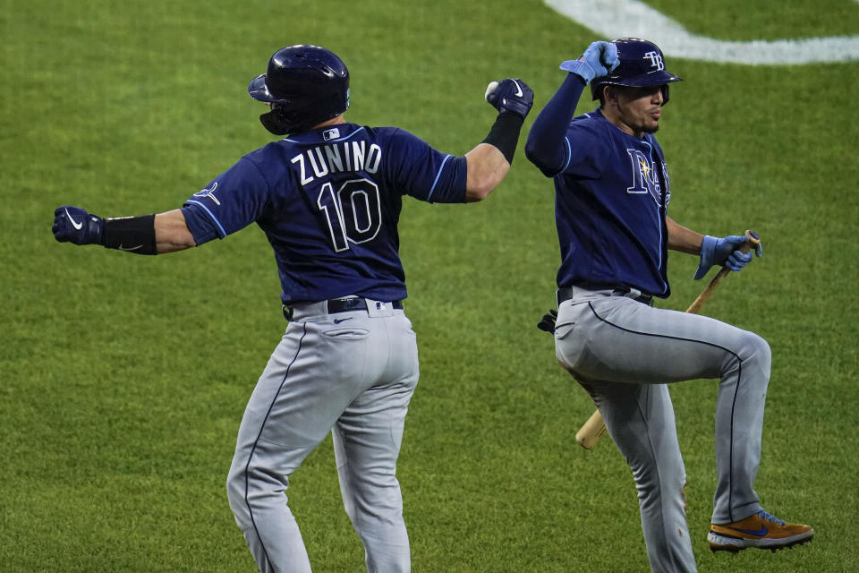 Tampa Bay Rays' Mike Zunino, left, celebrates near home plate with Willy Adames after hitting a two-run home run against Baltimore Orioles relief pitcher Tyler Wells during the third inning of a baseball game, Tuesday, May 18, 2021, in Baltimore. Rays' Joey Wendle scored on the home run. (AP Photo/Julio Cortez)