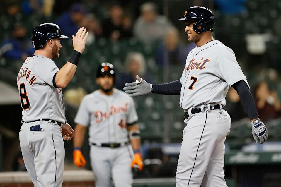 Robbie Grossman #8 and Jonathan Schoop #7 of the Detroit Tigers celebrate a two run home run by Schoop during the second inning against the Seattle Mariners at T-Mobile Park on May 17, 2021.