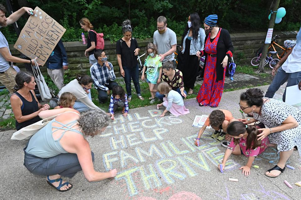 BROOKLYN, NEW YORK - JULY 12: Parents and children celebrate new monthly Child Tax Credit payments and urge congress to make them permanent outside Senator Schumer's home on July 12, 2021 in Brooklyn, New York. (Photo by Bryan Bedder/Getty Images for ParentsTogether)