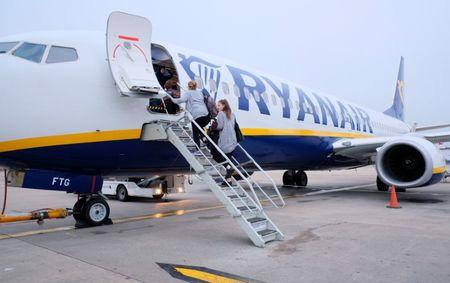 Passengers board a Ryanair flight at Stansted Airport